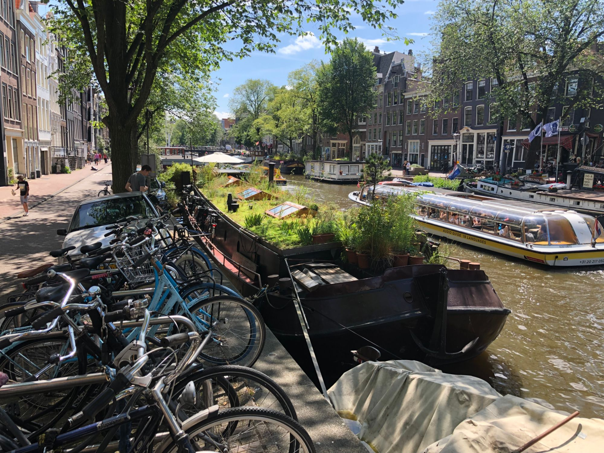 Free stock photo Amsterdam canal boat bikes buildings