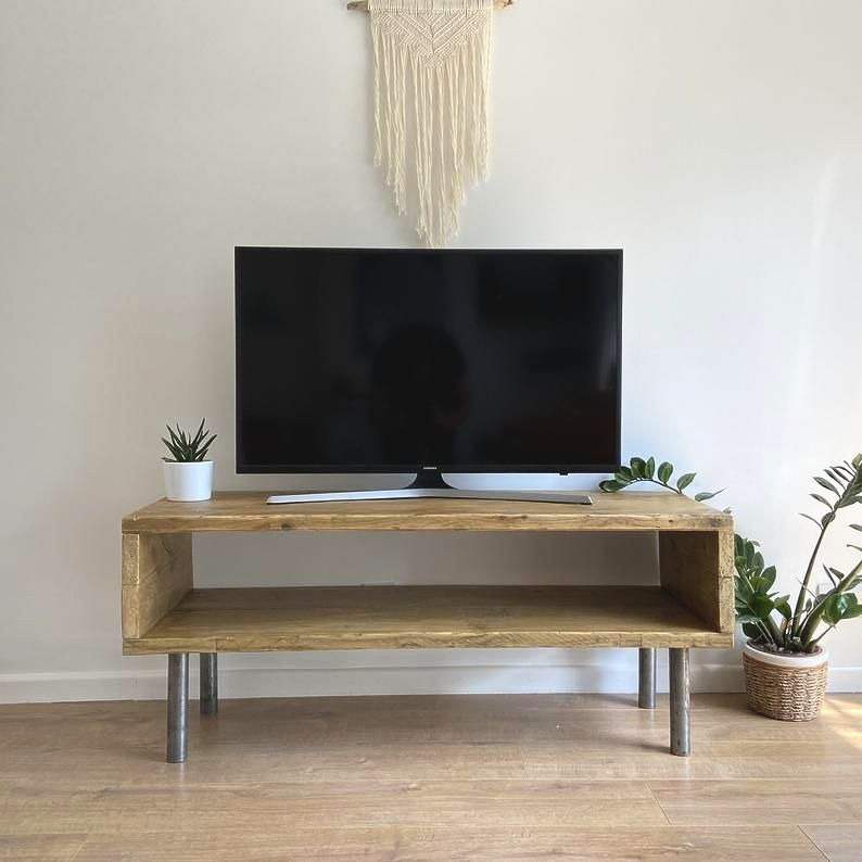 Rustic reclaimed wood TV stand with industrial scaffold tube legs
