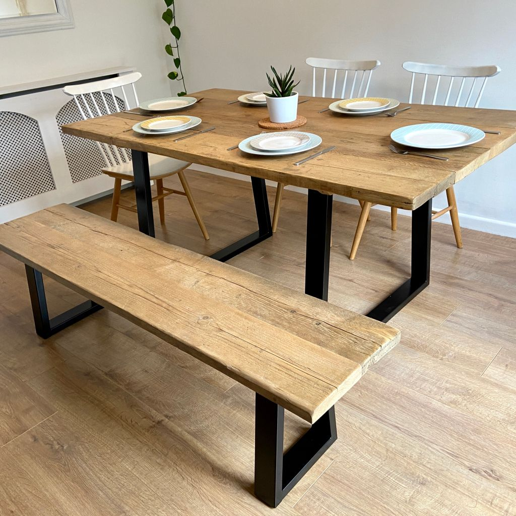 Rustic reclaimed wood dining table + bench - industrial trapezium frame leg