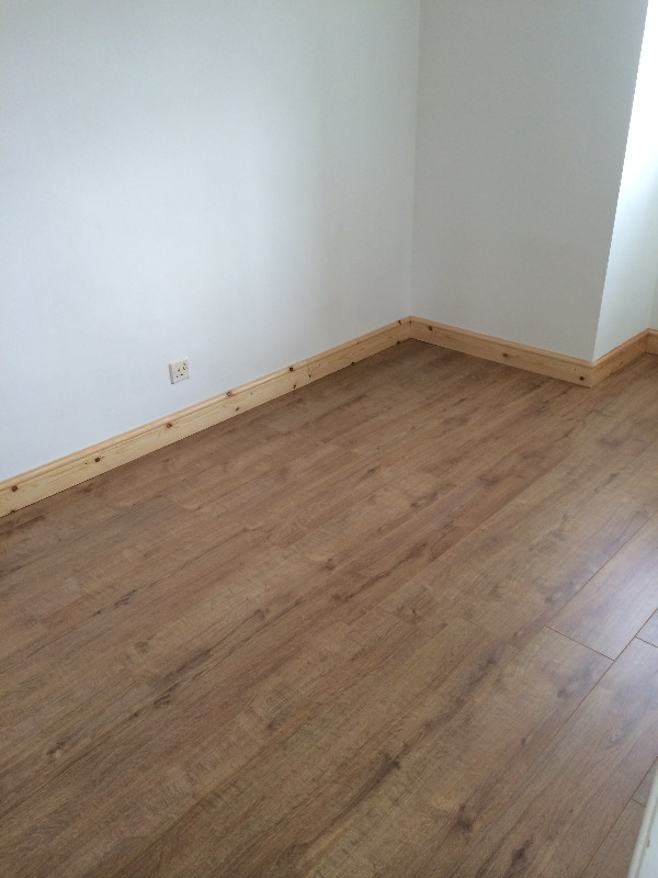 new white walls pine skirting oak style laminate floor
