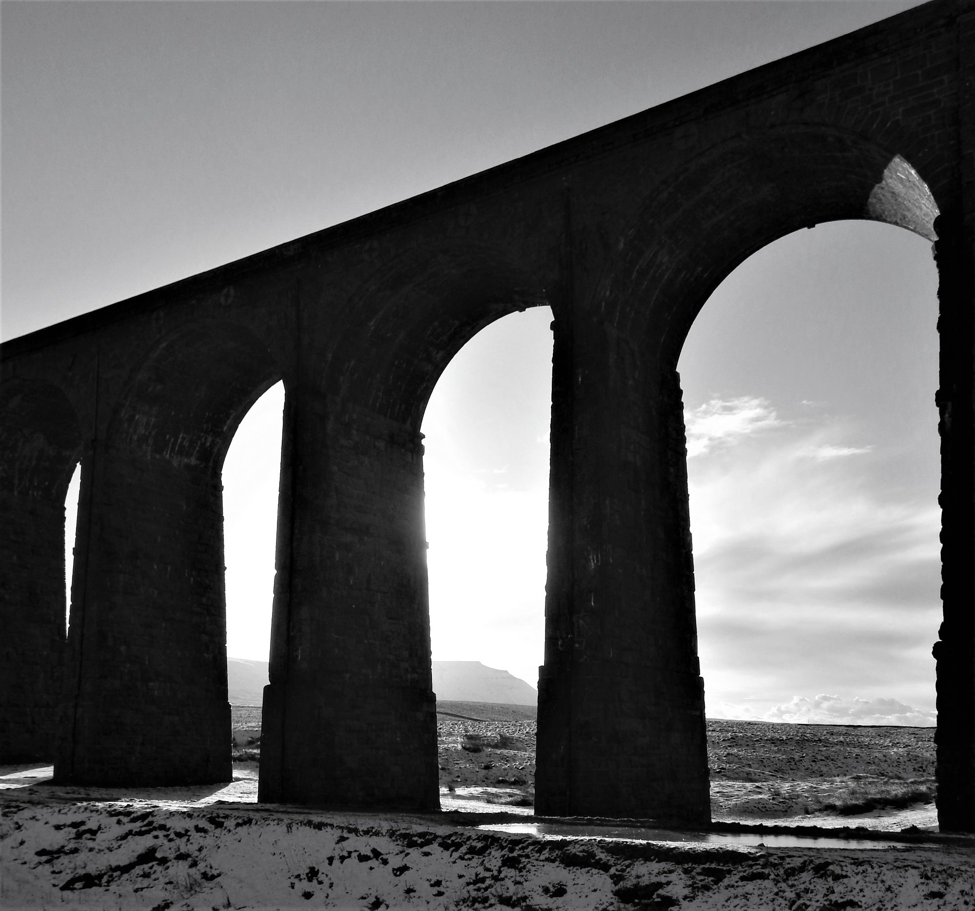 Ingleborough viewed through Ribblehead Viaduct