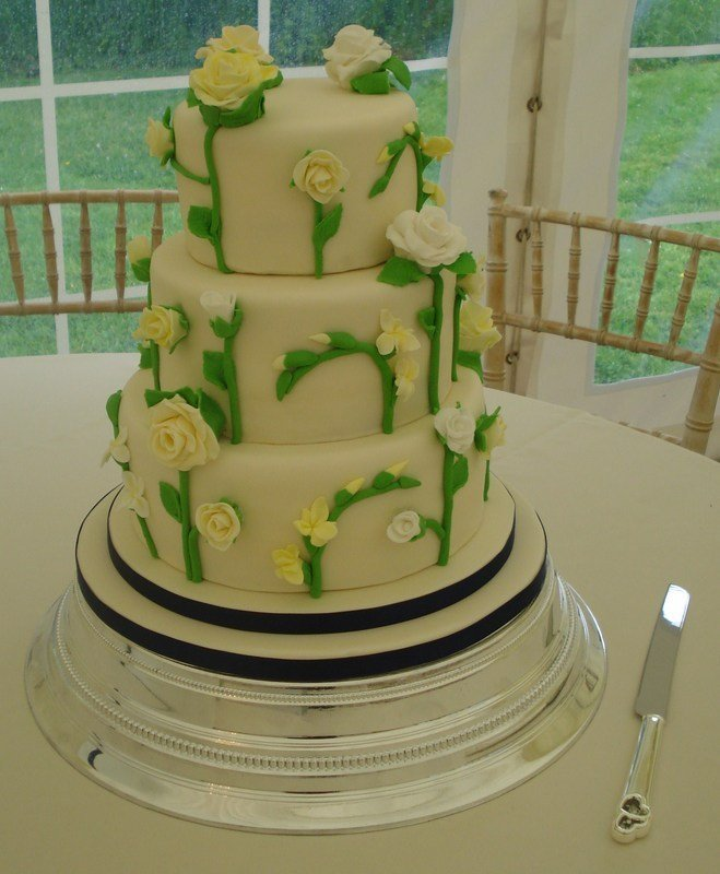 Roses and freesias wedding cake