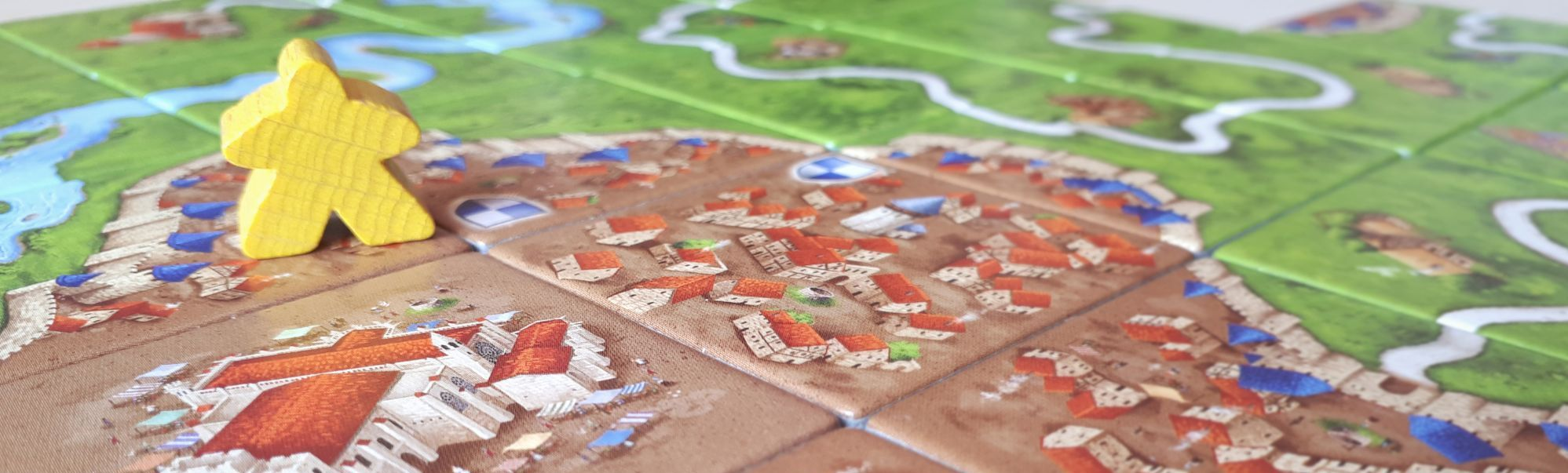 Carcassonne Game with Yellow Meeple