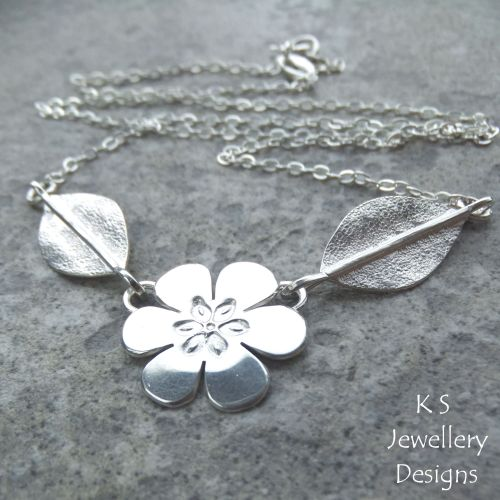 Six Petal Flower and Leaves Sterling Silver Necklace