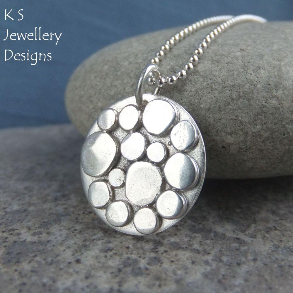 Random Pebbles Circular Sterling Silver Pendant