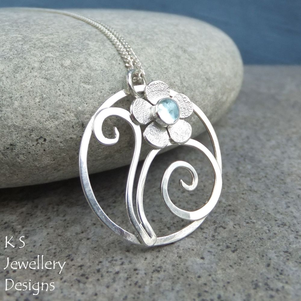 Blue Topaz Flower and Swirls Sterling Silver Circle Pendant