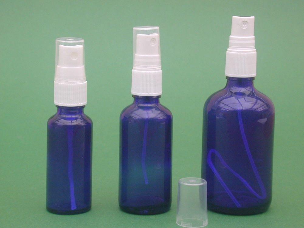 Blue glass bottle white finger spray