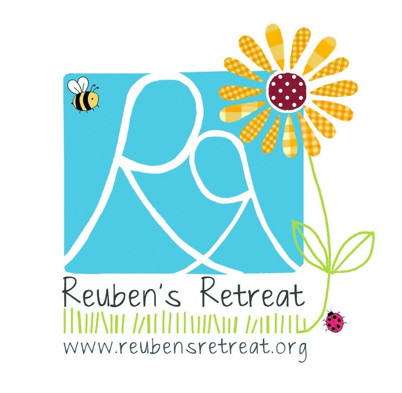 reubens retreat logo with web