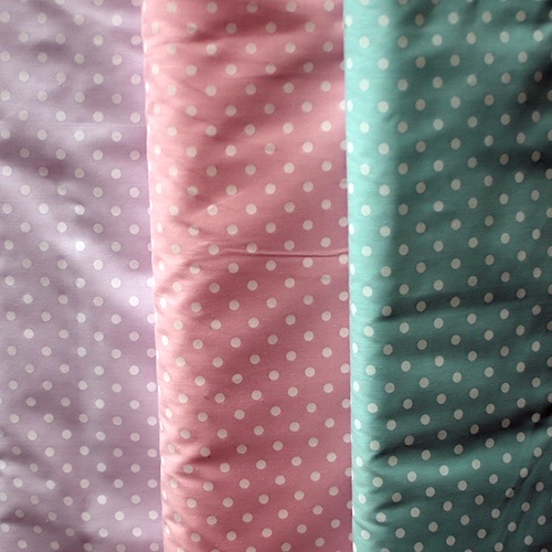 Pastel poly cotton with white small spots - Sold by the metre