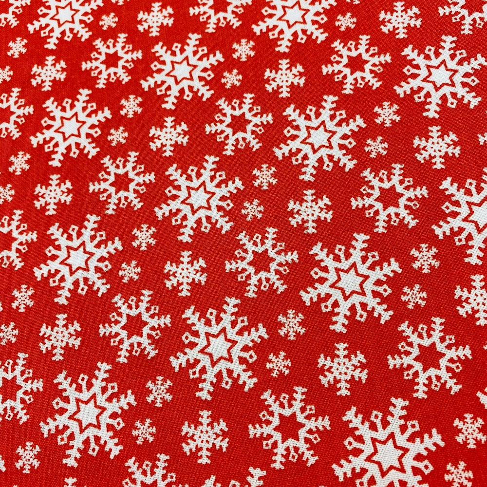 Red with white snowflakes. - Sold by the half metre
