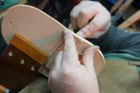 19) Traditional saddle stitching on the pony