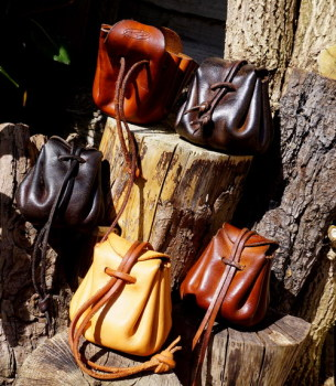 Beaver Bushcraft leather merchants purses in aged leather group picture