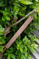 Sharpening-old field strop in Mink length ways hanging from Tree