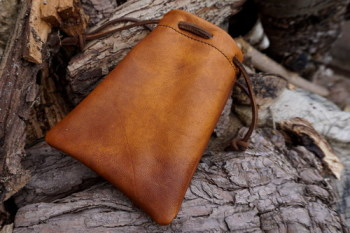Leather-soft hand dyed tinder pouch on won by beaver bushcraft