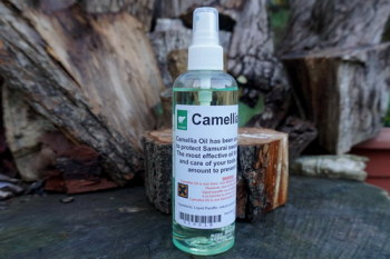 Cutting -large bottle of camellia Oil at Beaver Bushcraft