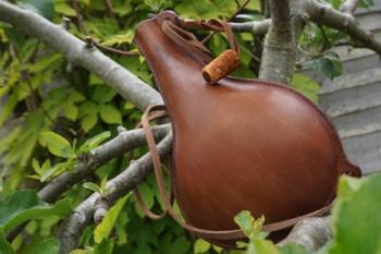 handmade leather drinking bottle in hazel brown for beaver bushcraft