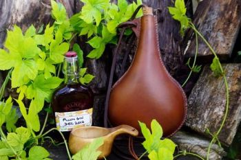 leather hand stitched cross stitched leather bottle for beaver bushcraft