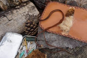 leather pioneering pouch in oiled calf open with altoids tin for beaver bus