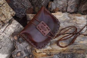 leather chestnut brown pioneering pouch ready to go for beaver bushcraft
