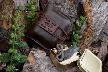 leather fire hand stitched pioneering pouch in wallnt for beaver bushcraft
