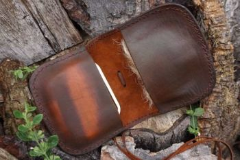 leather hand stitched pioneering pouch showing inner side and tinder for be