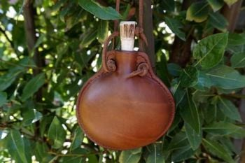 leather bottle handmade in hazel handmade for beaver bushcraft