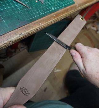 Sharpening new traditional strop for beaver bushraft Mark demostrating