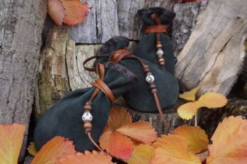 Leather soft medicine pouches hand finished detail by beaver bushcraft