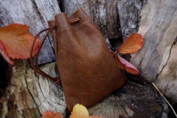 Fire leather aged hand dyed lether pouch in soft brown shade by beaver bush