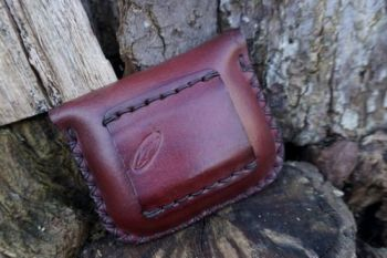 leather hand dyed mahogany pouch with tooled detail back view by beaver bus