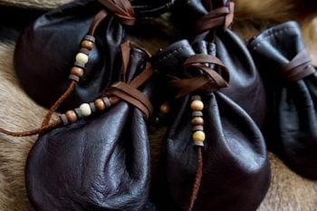 Leather hand dyed leather mahogany medicine pouches for beaver bushcraft