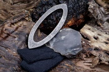 Fire pointed oval fire steel made by beaver bushcraft with flint and steel