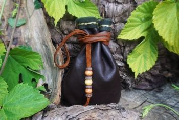 leather close up hand stitched detail medicine pouch with leather beaded de