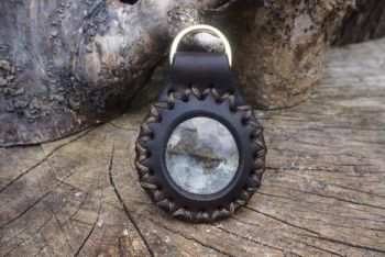 fire and leather solar lens on D ring hand stitched and hand dyed in walnut