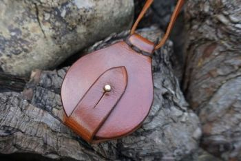 leather and fire hand dyed solar pendant in conker wallet