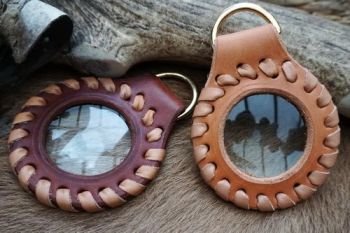 Leather and fire hand laced solar pendants by beaver bushcraft