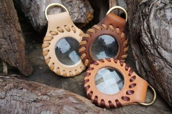 fire and leather hand laced saddle tan solar pendants in natural laether f