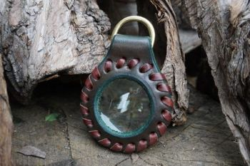 fire and leather hand dyed hand laced solar pendnat by beaver bushcraft in