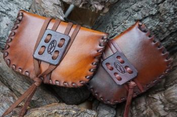 leather ready made pioneering pouches laced edge for beaver bushcraft.