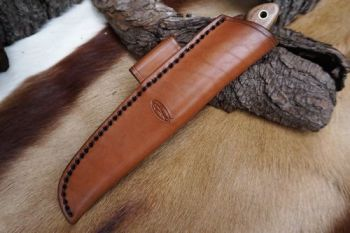 cutting beaver bushcraft survival knife with thick saddle stitch detail