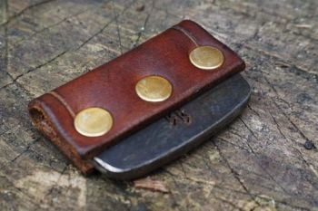 Fire and leather flint and steel striker with brass studs for beaver bushcr