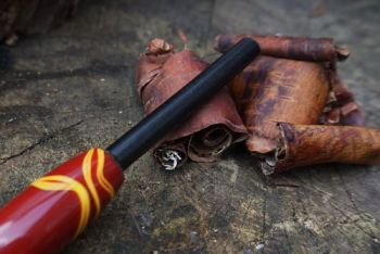fire red and yellow handled ferro rod for beaver bushcraft