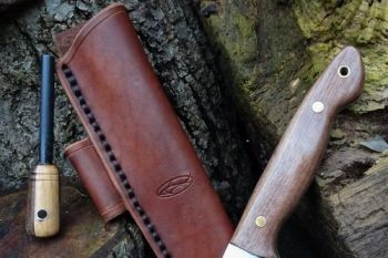 cutting bushcraft knife made for beaver bushcraft dark russet leather sheat