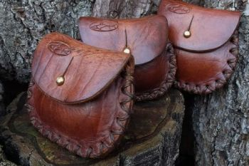 Leather aged tinder purses hand stitched by beaver bushcraft