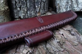 Cutting close up of hand stitched sheath for the shark bushcraft knife