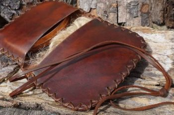 leather ready to go pioneering pouch open to show tinderbox and tinder for