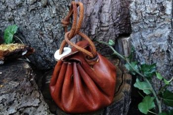 leather and fire merchant purse with belt loop made by beaver bushcraft