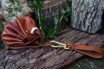 leather and fire belt loop with merchant purse tinder pouch at beaver bushc