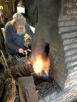 BF Randy at the fire making our fire steels