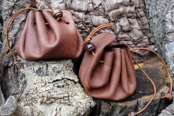 Leather vintage leather merchant pouches made by beaver bushcraft